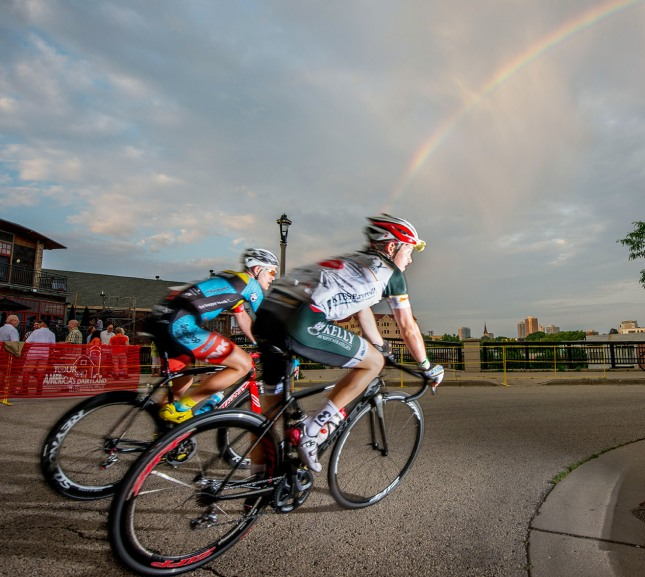 Racing under the rainbow during the Schlitz Park Criterium in the Tour of America's Dairyland